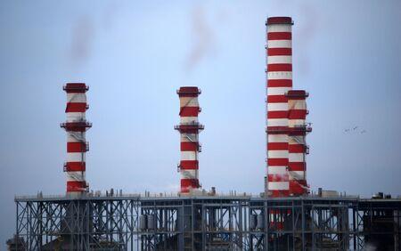 smokestacks: Industrial smokestacks polluting the sky Stock Photo