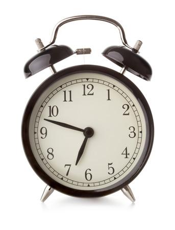 single vintage alarm clock isolated on white background