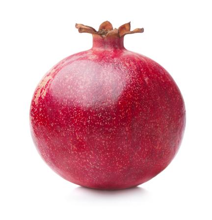 Single ripe pomegranate isolated on white background