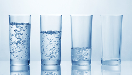 set of glasses with various amount of water Stok Fotoğraf