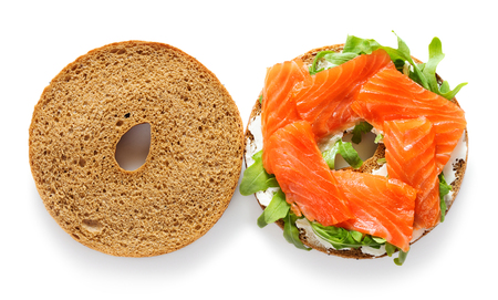single fresh bagel sandwich with salmon, arugula and cream cheese isolated on white background 免版税图像