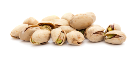 heap of ripe pistachios isolated on white background