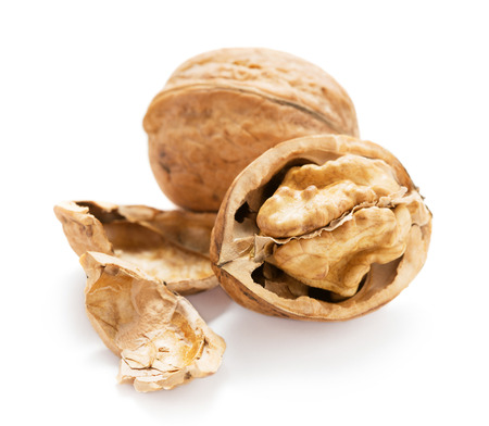 whole and cracked walnut isolated on whte background