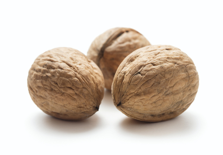 heap of walnut isolated on whte background Imagens