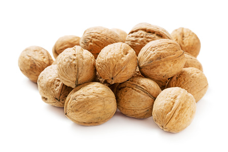 heap of walnut isolated on whte background Stock Photo