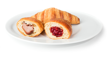 croissants with chocolate and raspberry jam on white plate isolated on white backgrond