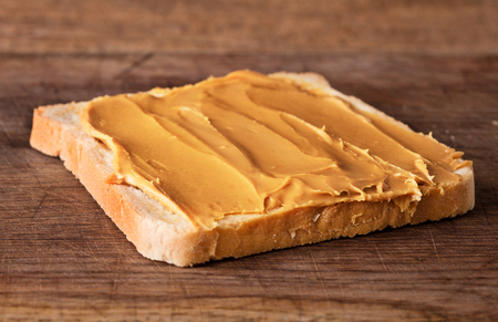 close-up view of peanut butter sandwich on wooden background Foto de archivo