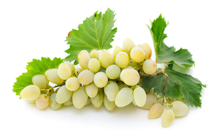 close-up view of bunch of ripe white grapes with leaves solated on white background Imagens