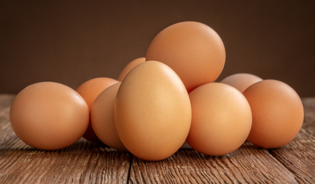set of chicken eggs on wooden background