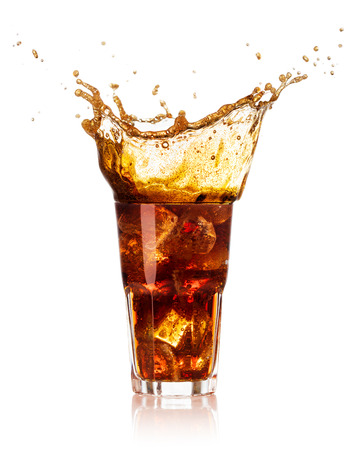 glass of cola with splash and drops isolated on white background