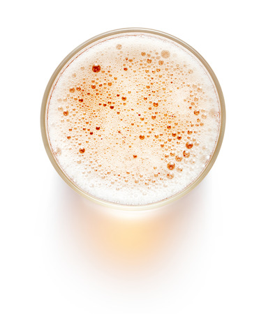 top view of glass of beer isolated on white background