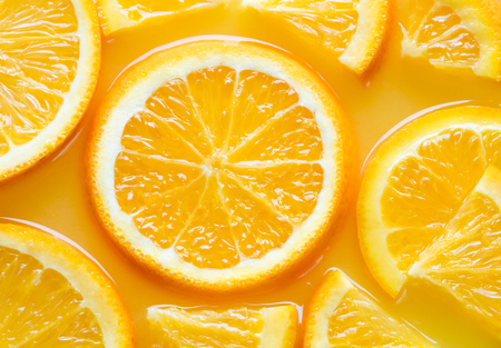 top view of orange slices in juice as texured background Imagens