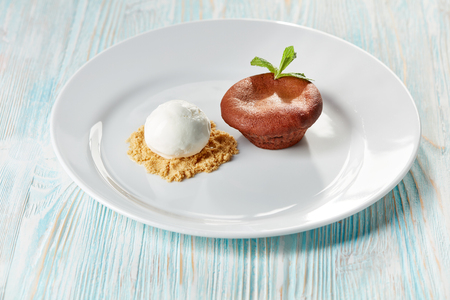 chocolate fondant with ice cream on wooden background