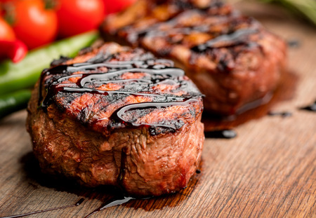 grilled beef steak with hearbs steak on wooden background