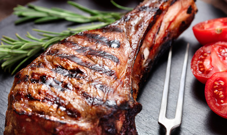 grilled beef steak with hearbs steak on slate background Imagens