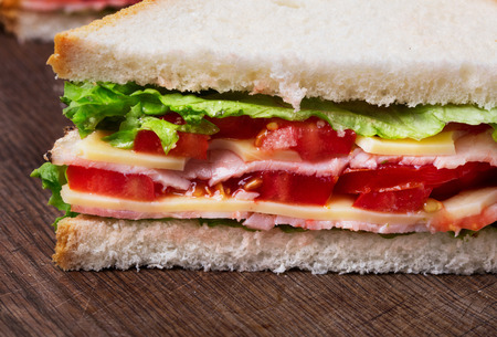 close-up view of fresh sandwich on wooden background Imagens