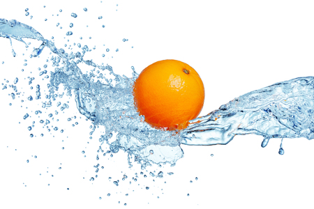 single orange fruit in blue water splash