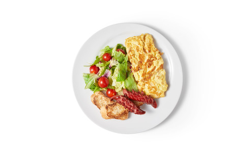 fresh breakfast with egg and vegetable in plate on blue wooden table