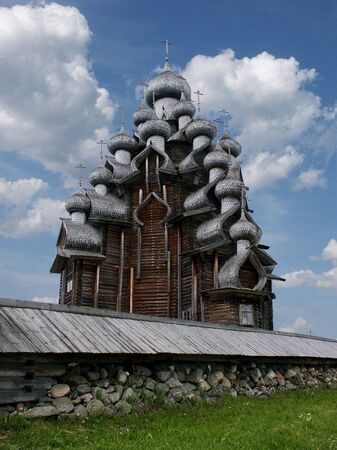 onega: Old wooden big church with stone wall on the lake Onega