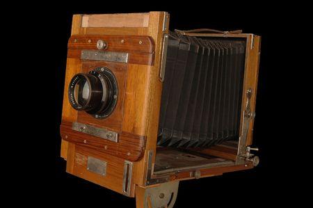 viewfinder vintage: Expanding antique photo camera on black background   Stock Photo