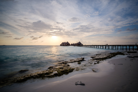Water bungalows and jetty in indian sea. Long exposure.