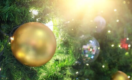 Blurry of Christmas and New Year's balls with beautiful decorations on the Christmas tree, soft light, beautiful background images and illustrations.