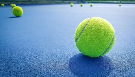 Close-up shots of tennis balls on a blue background field Stock Photo