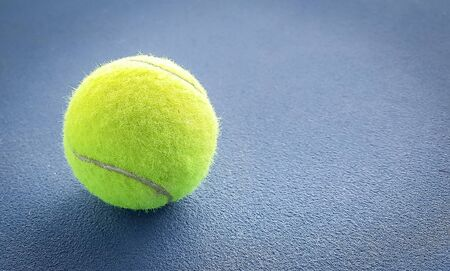 Close-up shots of tennis balls on a blue background field