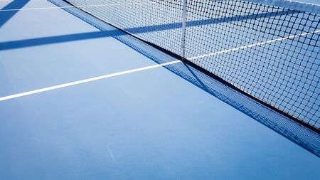 Tennis court with a background with shadows
