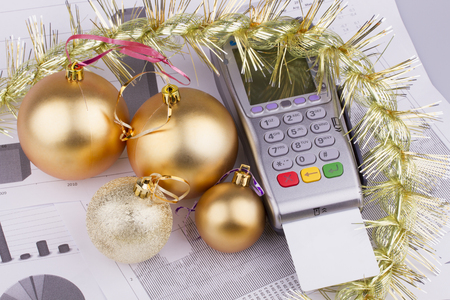 Business Christmas - tables, payment terminal, credit Cards, balls photo