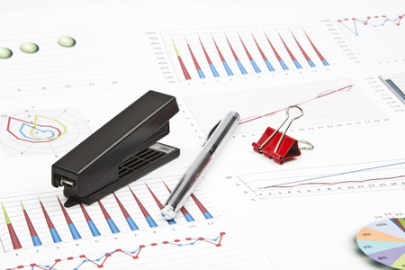 charts graphs: Business still-life of a charts, graphs, paperclips, stapler