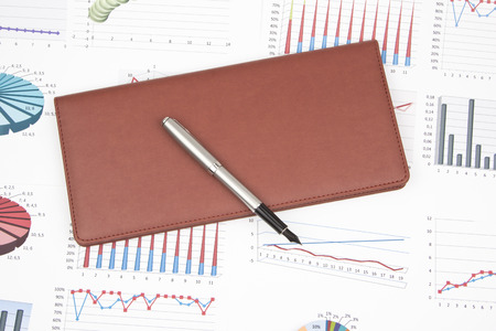 card holder: Business still-life of a charts, ink pen, card holder