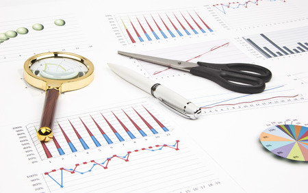 charts graphs: Business still-life of a charts, graphs, pen, magnifier, scissors Stock Photo