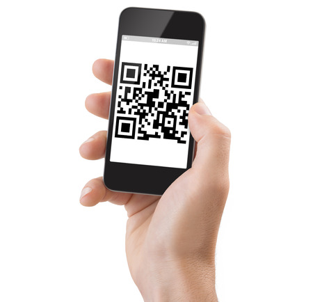 cut out device: Studio Shoot of a adult mans hand holding a generic smartphone scanning a Qrcode.