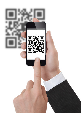 qr code: Studio Shoot of a adult mans hand holding a generic smartphone scanning a Qrcode.