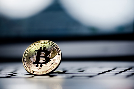 processors: Golden Bitcoin money on computer.