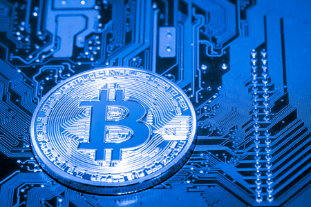microprocessor: Abstract,Golden Bitcoin money on computer.