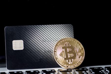 close up of Golden Bitcoin money on computer.