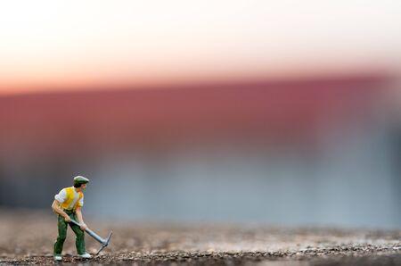 people mining on sky sunset background.