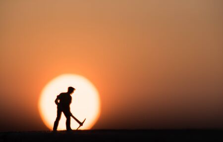 Abstract,silhouette people mining on sky sunset background.