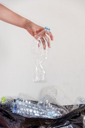 Plastic bottles in black garbage bags waiting to be taken to recycle.