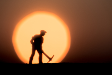 Abstract,silhouette Model people mining on sky sunset background. Stock Photo