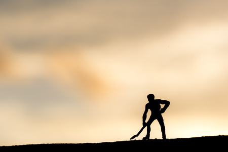 Abstract,silhouette Model people mining on sky sunset background. Imagens