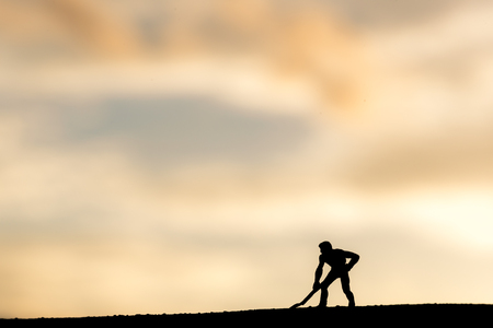 Abstract,silhouette Model people mining on sky sunset background. Banco de Imagens