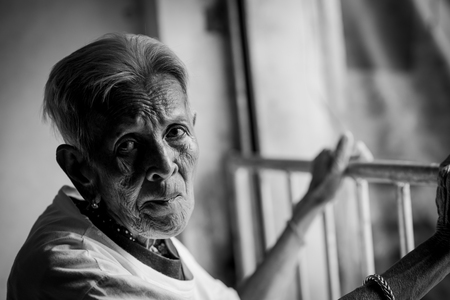 The old womans felling lonely. ,shes senior woman in family and the elderly.