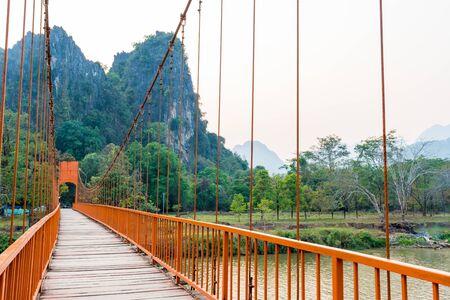 Orange bridge over song river Landmark in Vang Vieng,Laos