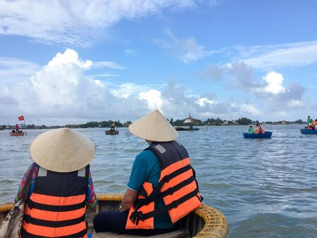 Tourists riding bamboo basket boats in Hoi An, Vietnam