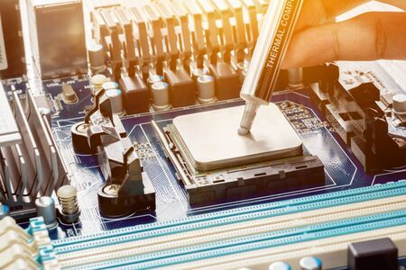 close up of Silicone CPU or Thermal Compound on Mainboard Electronic computer.