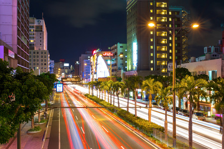 A long exposure shot of a street in Okinawa with cars passing by Editorial