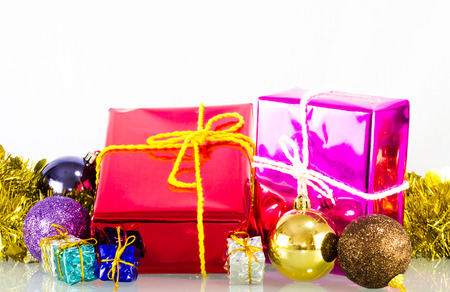 Gift box and christmas ball on white background photo